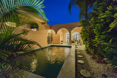 A warm romantic Mayan evening by the pool with family and friends