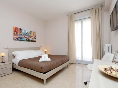 Photo for Bright and stylish two bedroom apartment, for up to five guests, situated in an authentic Rome neigh