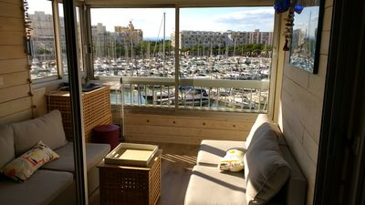 Photo for Carnon apt 60m2, beautiful harbor view, beach access 50m, air conditioned