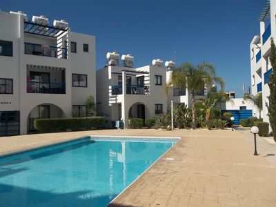 Photo for Well Equipped Apartment, Communal Pool, Central Location with wifi /satelite tv