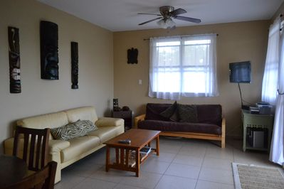 Living room with pull out sofa , Dish network tv,dvd player, playstation and more