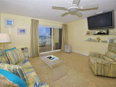 Our oceanfront condo is breezy and spacious! - From the 4th floor, you'll be able to see for miles from our ocean front balcony. And after the sun goes down, turn on the HDTV and catch up on movies and shows while you stretch out on the comfy couch that unfolds into a bed for 2.