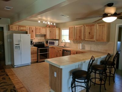 Large, fully functional kitchen with all necessary appliances, pot, pans etc.