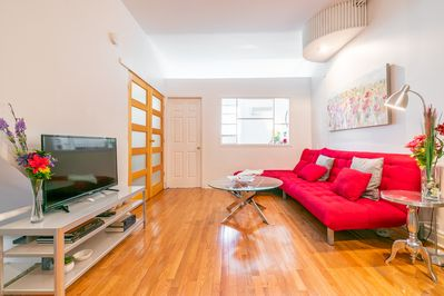 Gorgeous living room with double pull out bed, single lounger, TV with ROKU