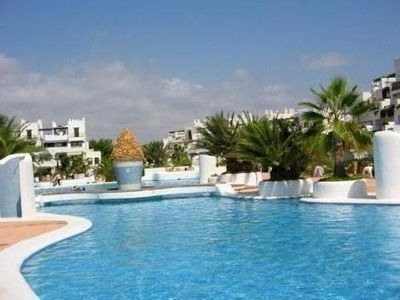 Photo for Stunning apartment with private garden overlooking pools with Wifi & Sky TV