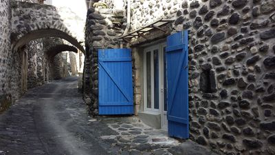 Photo for Independent room. Atypical house. Medieval hamlet at the foot of the volcanic neck