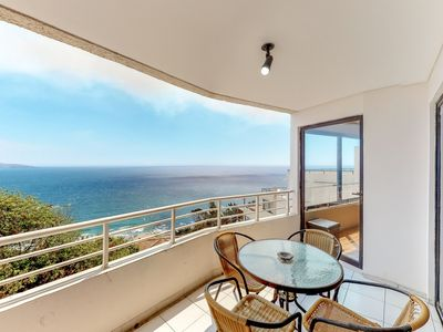 Photo for Gorgeous oceanfront condo with a shared pool - blocks from the beach!