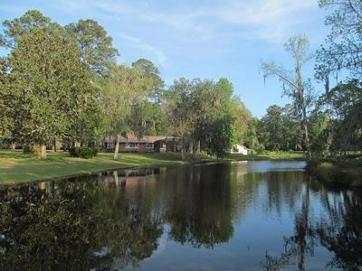 Enjoy the Screened Pool, Fishing, Private Tennis and Riverfront with Dock.