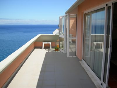 Photo for Beach front penthouse apartment in coastal resort of Caniço de Baixo