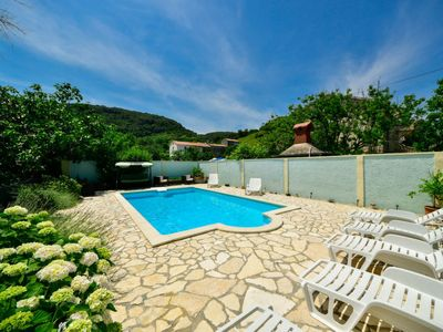 Photo for 2 bedroom Apartment, sleeps 4 in Supetarska Draga with Pool, Air Con and WiFi