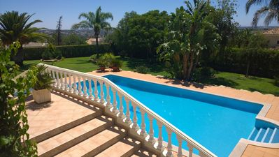 Photo for Set in an acre with coastal views, heated pool and close to many golf courses