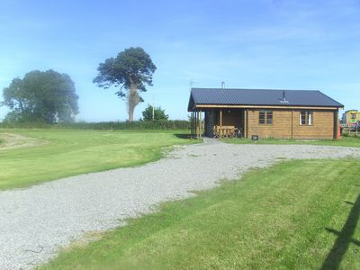 Photo for Curlew Lodge -  a fabulous and very comfortable beachside log chalet with stunning views and woodbur