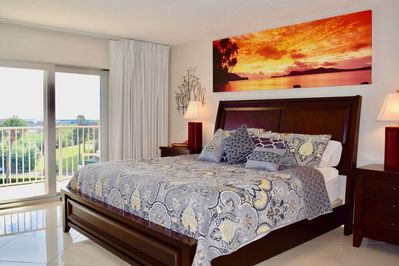 Master bedroom with direct ocean views and a balcony.