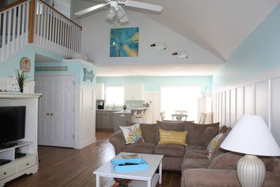 Bright, spacious great room with huge comfy furniture to relax and entertain