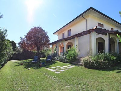 Photo for Beautiful private villa for 9 guests with A/C, WIFI, TV, patio and parking, close to Viareggio