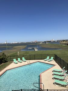 Splash around in your private waterfront pool with a view of OC & boats at play