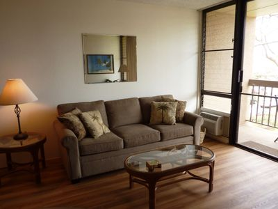Living Room with AC, large patio door to lanai.