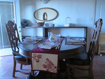 Dining room table extends to seat 8 people with side benches.