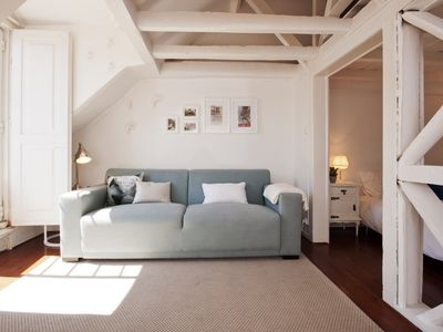Photo for Bright, superb loft-style apt at Baixa with AC, terrace, and free parking