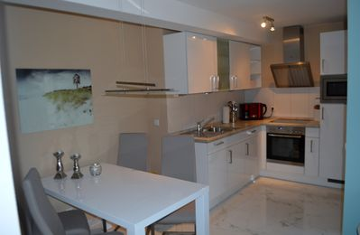 Photo for NEW modern apartment with sea views, direct beach access and a sauna