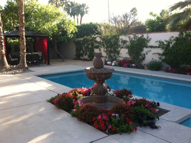 Fountain with the swimming pool and outdoor patio. Spacious Newly Remodeled Home In The      HomeAway Palm Springs