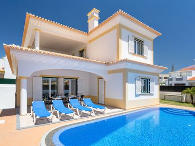 Photo for 4 bedroom Villa, sleeps 11 with Air Con, FREE WiFi and Walk to Beach & Shops