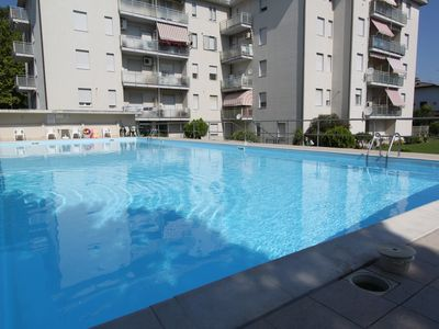 Photo for Spacious and bright two-room apartment for summer rental with beautiful views and swimming pool