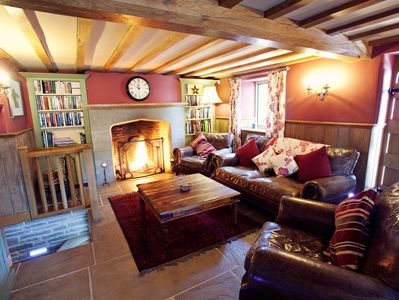 Barn sitting room with open fire