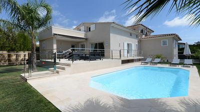 Photo for VILLA standing 800 m from the sea, air conditioned with heated pool