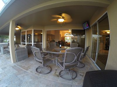 Lanai Table, Chairs and Mounted TV.  My favorite place to sit and unwind.