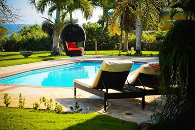 Sun bathing and relaxing by the private and ocean view swimming pool