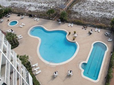 View of Pools and Hot Tub from the Balcony! Lap pool is heated seasonally