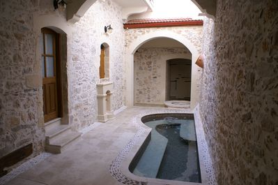 Spa pool located on the ground floor. Selene's front door is left past the pool