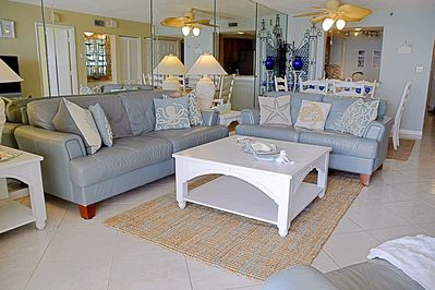 Upscale Living room with plenty of seating.  2 sofas and large chair.