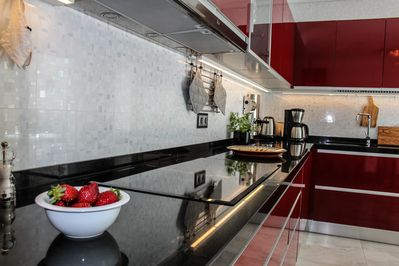Kitchen with stone top and induction hob