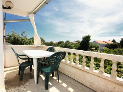 Photo for Three bedroom apartment with terrace and sea view Kampor, Rab (A-5014-a)