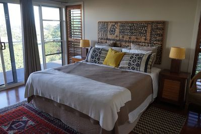 Master bedroom has super king bed & access to front balcony
