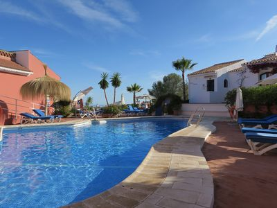 Photo for Holiday townhouse with shared pool & private garden, unlimited wifi included