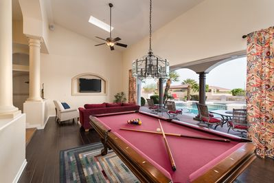 Entertainment Room with Glass wall open to outdoor dining area and pool.