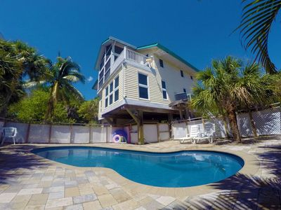 Large private heated pool with expansive lounging space to soak up Florida rays