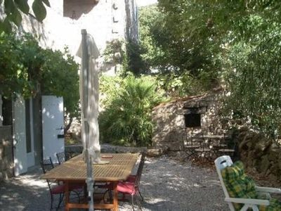 Photo for Traditional granite house with heated pool in small hamlet