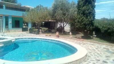 Photo for Rustic villa rental in Orihuela Costa with pool and large wooded garden.