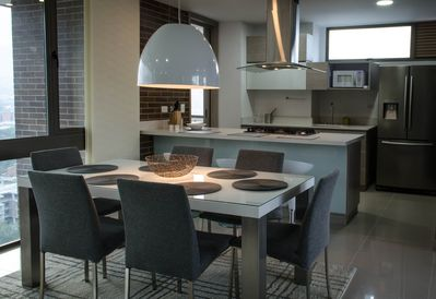 Sit down down with love ones to a quiet dinner or relax at the kitchen bar