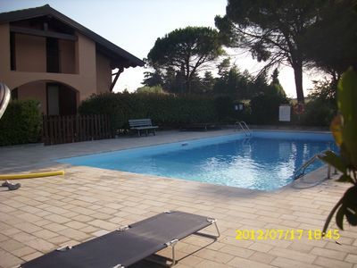 Photo for Detached house, private garden pool 100 meters from the lake, Wi-Fi