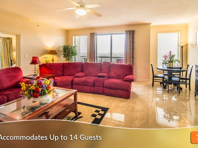 Photo for Steps to the Beach! Spacious w/ Large Wraparound Balcony. Perfect for Families & Groups!