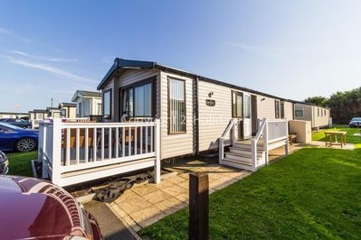 8 berth accommodation with decking at Caister Haven Holiday Park
