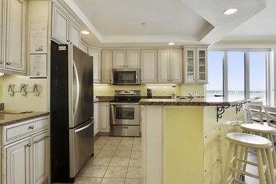 Modern Kitchen with Stainless Appliances and Granite Countertops