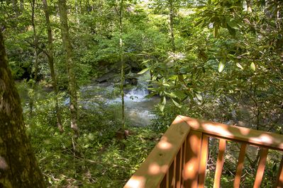 Listen and watch the river straight from the cabin's 180 degree balcony.