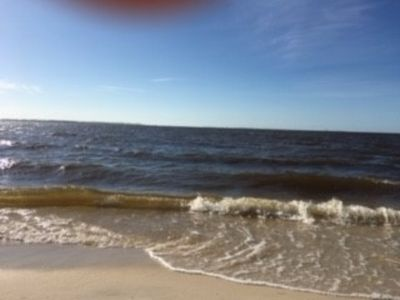 Photo for One minute walk to the beach.10 minutes walk  into downtow. 5 miles from I-10.