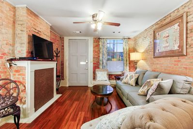 Looking back to the front door, the exposed brick is part of the original house.